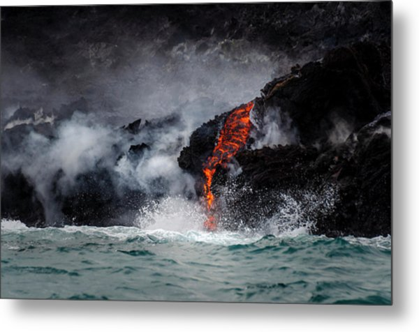 Lava Dripping Into The Ocean Metal Print