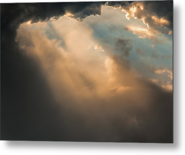 Light Punches Through Darkness Metal Print