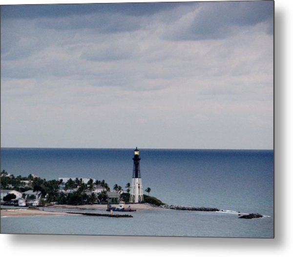 Lighthouse And Rain Clouds Metal Print