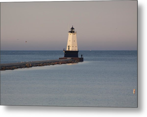 Lighthouse At Sunset Metal Print by Chuck Bailey
