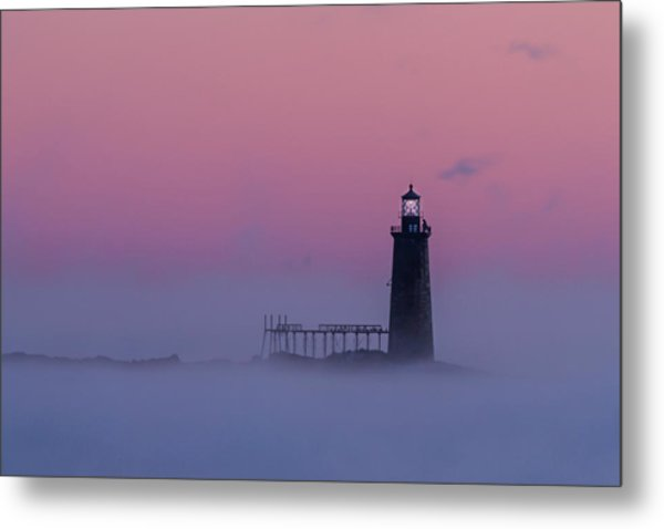 Lighthouse In The Clouds Metal Print
