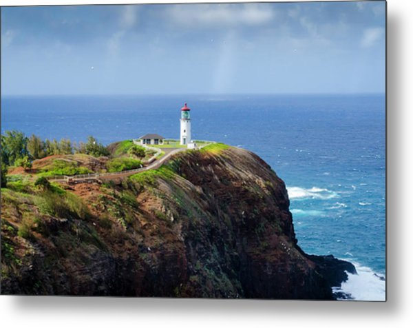 Lighthouse On A Cliff Metal Print