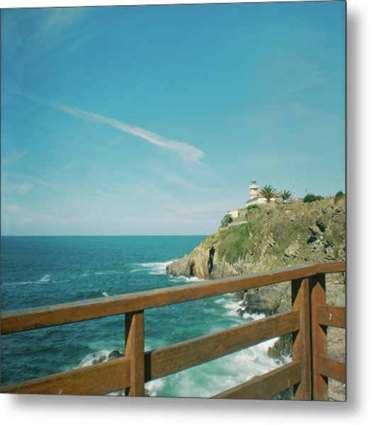 Lighthouse Over The Ocean Metal Print