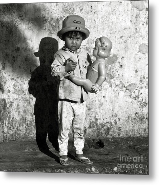 Little Vietnamese Girl Playing With Her Doll Metal Print