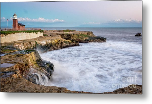 Long Exposure Of Waves Against The Cliff With Lighthouse In Shot Metal Print