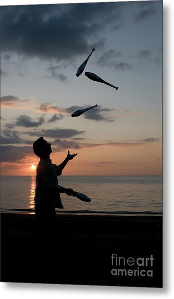 Man Juggling With Four Clubs At Sunset Metal Print