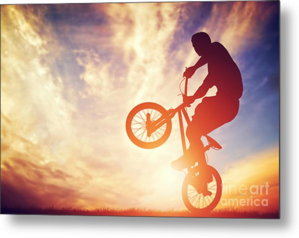 Man Riding A Bmx Bike Performing A Trick Against Sunset Sky Metal Print