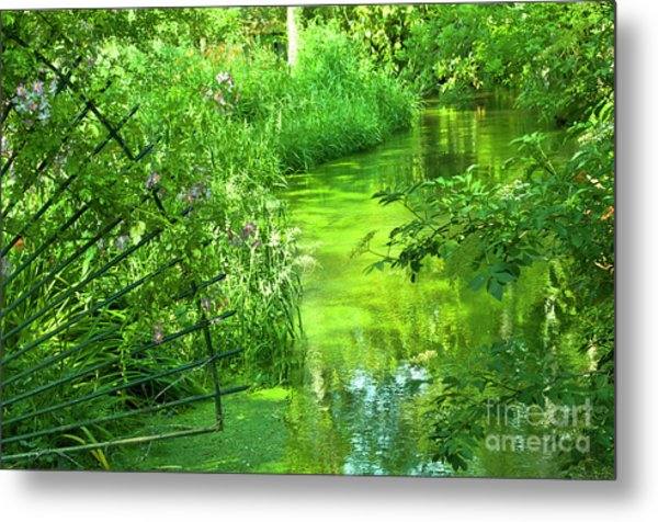 Monet's Green Garden Metal Print