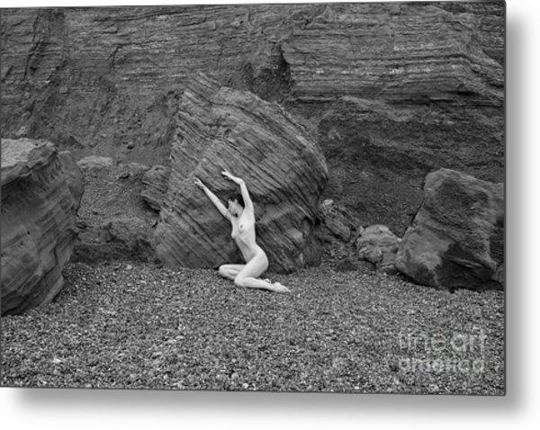 Nude Woman Pulling Shape By Rocks Metal Print