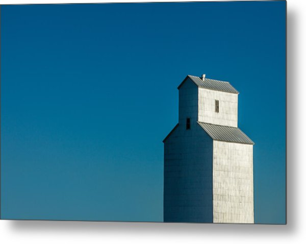 Old Grain Elevator Against Steel Blue Sky Metal Print