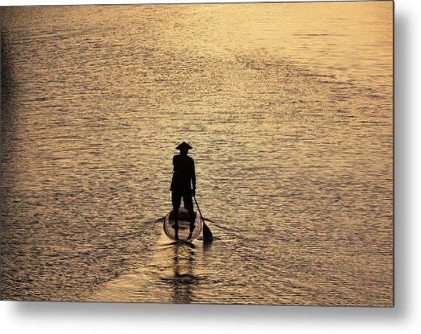 Old Man Paddling Into The Sunset Metal Print