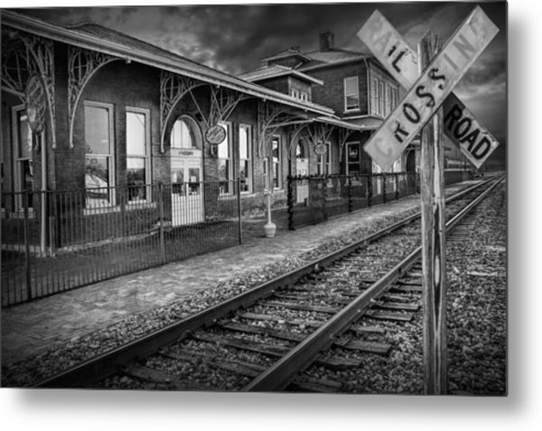 Old Train Station With Crossing Sign In Black And White Metal Print
