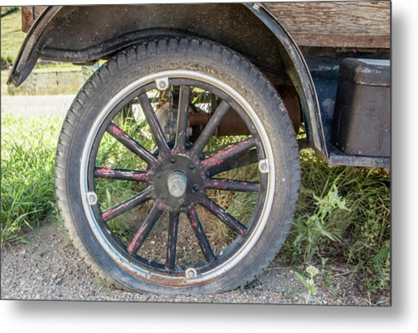Old Truck Tire In Rural Rocky Mountain Town Metal Print