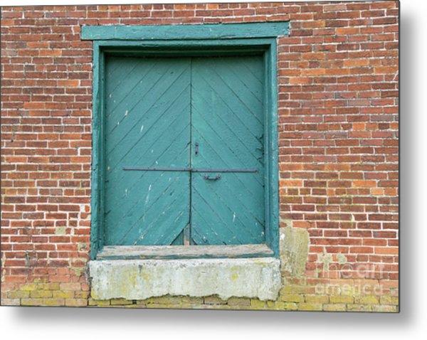 Old Warehouse Loading Door And Brick Wall Metal Print