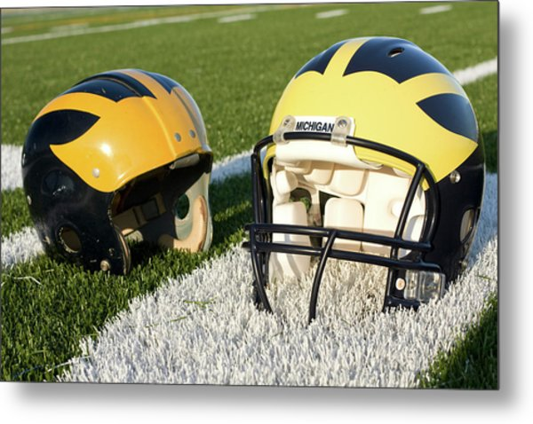 Metal Print featuring the photograph One Old, One New Wolverine Helmets On The Field by Michigan Helmet