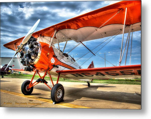 Orange Bi-plane Metal Print by Dan Crosby