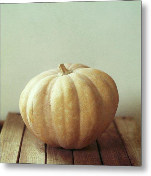 Pumpkin On Wooden Table Metal Print