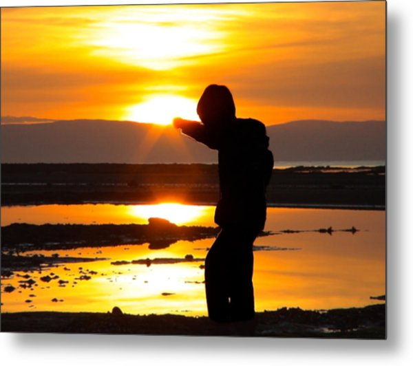 Punching The Sun Metal Print