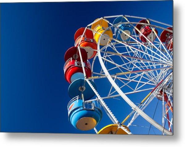 Rainbow Colored Carriages On Blue Metal Print