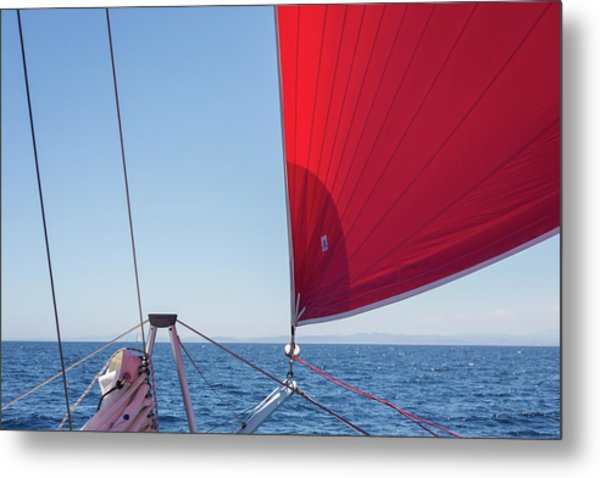 Metal Print featuring the photograph Red Sail On A Catamaran by Clare Bambers