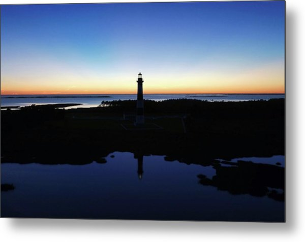 Reflection Of Bodie Light At Sunset Metal Print