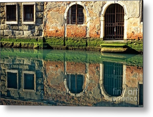 Reflection On Canal In Venice Metal Print by Michael Henderson