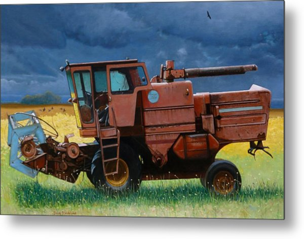 Retired Combine Awaiting A Storm Metal Print by Doug Strickland