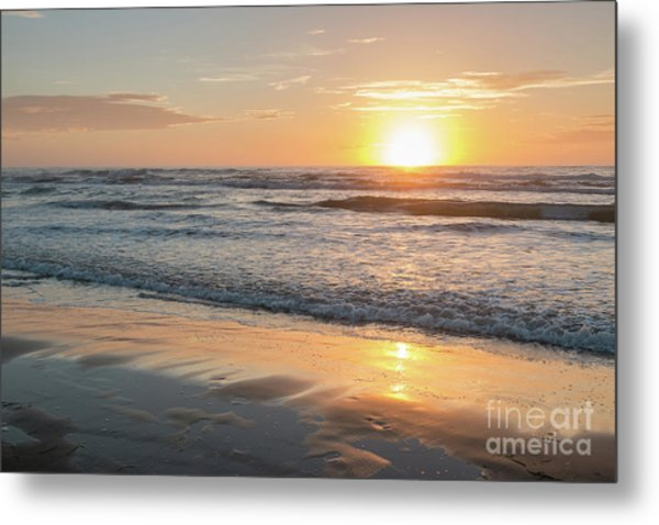 Rising Sun Reflecting On Wet Sand With Calm Ocean Waves In The B Metal Print