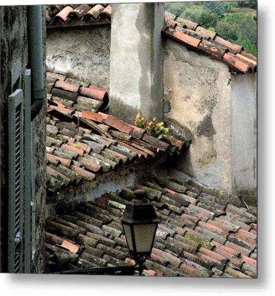 Rooftops Corsica Metal Print by John Bradburn