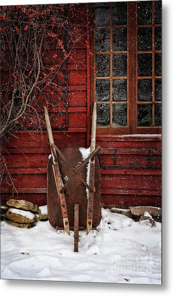 Rusty Wheelbarrow Leaning Against Barn In Winter Metal Print