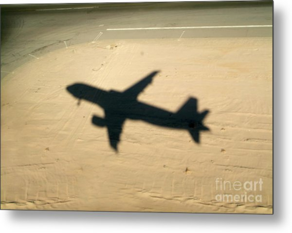 Shadow Of Airplane Flying Into Land Metal Print by Sami Sarkis
