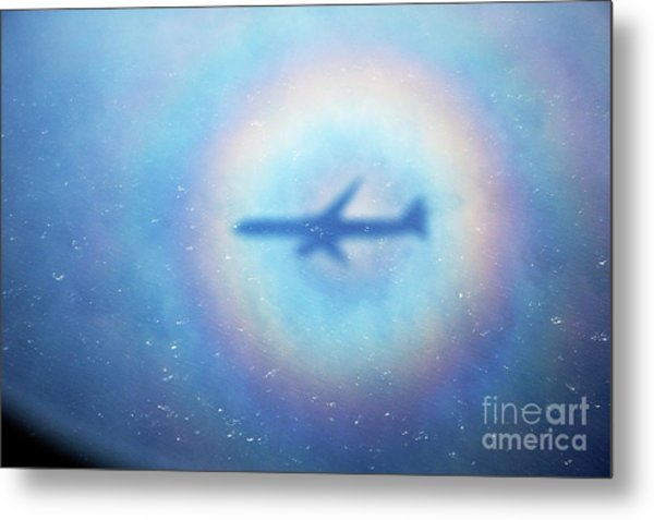 Shadow Of An Aeroplane Surrounded By A Rainbow Halo Metal Print by Sami Sarkis