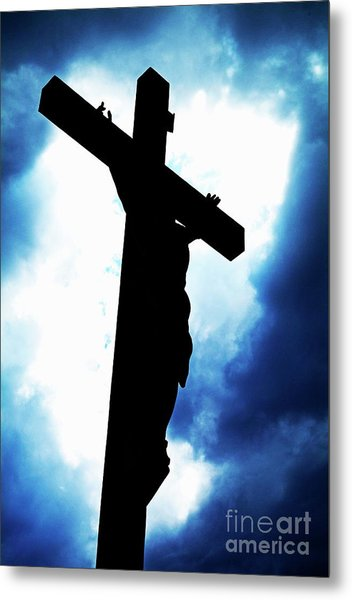 Silhouetted Crucifix Against A Cloudy Sky Metal Print by Sami Sarkis