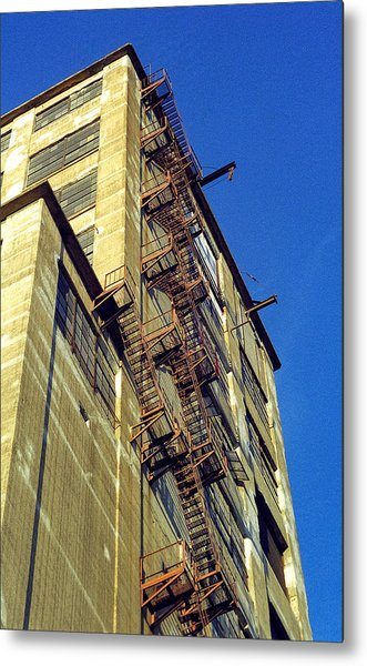 Metal Print featuring the photograph Sky High Warehouse by T Brian Jones