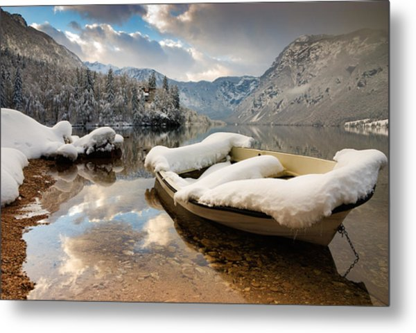 Snow Covered Boat On Lake Bohinj In Winter Metal Print