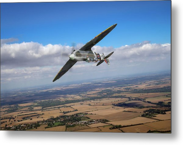 Metal Print featuring the photograph Spitfire Tr 9 On A Roll by Gary Eason