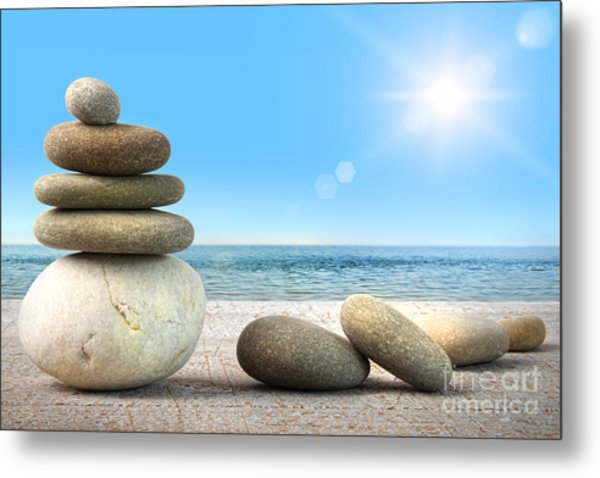 Stack Of Spa Rocks On Wood Against Blue Sky Metal Print