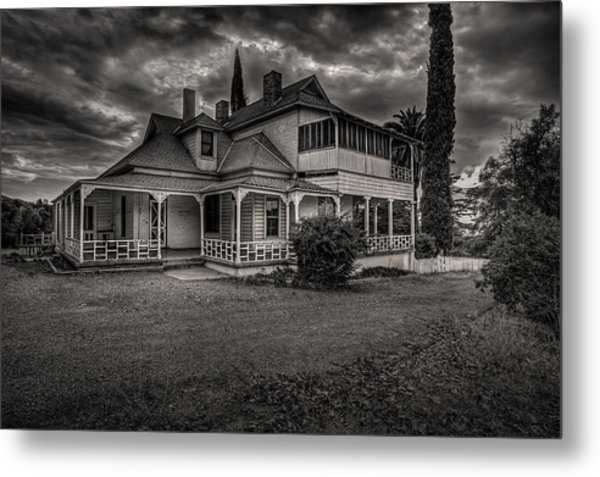 Storm Clouds Over Old House Metal Print