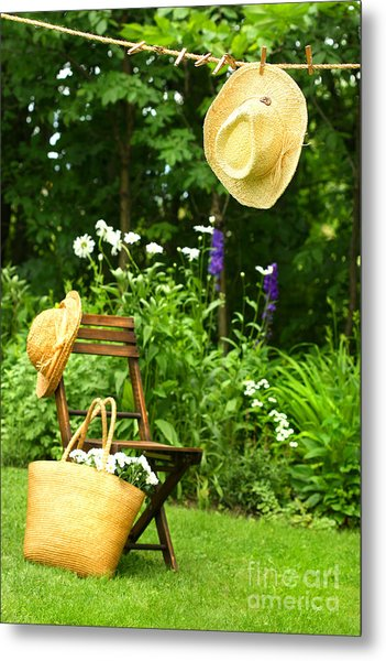 Straw Hat Hanging On Clothesline Metal Print