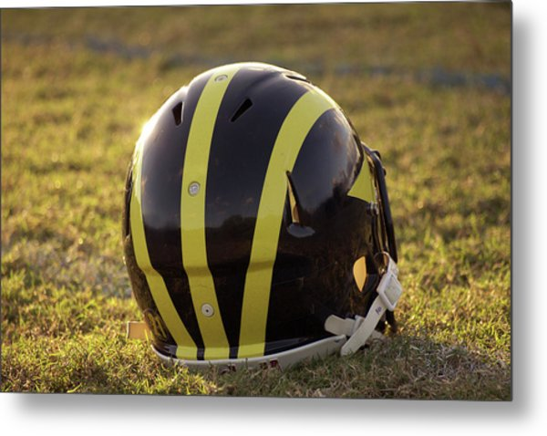 Metal Print featuring the photograph Striped Wolverine Helmet On The Field At Dawn by Michigan Helmet