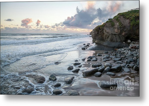 Sunset View In The Distance With Large Rocks On The Beach Metal Print