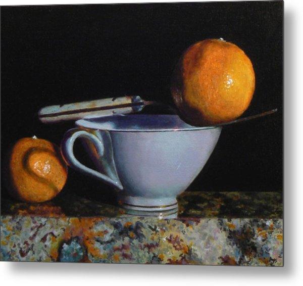 Teacup, Fork, And Two Oranges On Granite Metal Print by Jeffrey Hayes