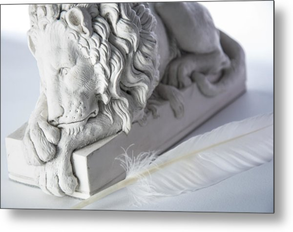The Lion And The Feather Metal Print