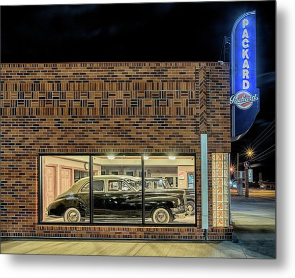 Metal Print featuring the photograph The Old Packard Dealership by Susan Rissi Tregoning