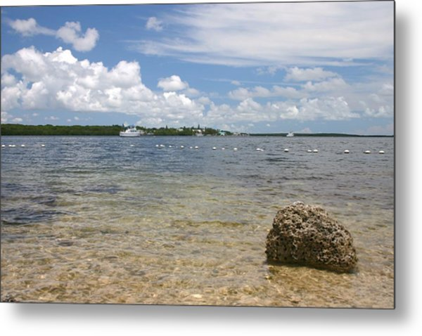The Rock In The Bay Metal Print by Dennis Curry