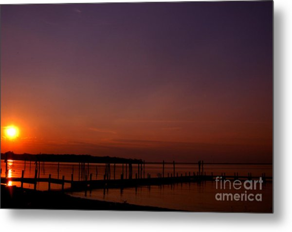 The Sun Sets Over The Water Metal Print