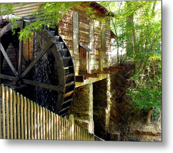 The Water Wheel Metal Print by Eva Thomas
