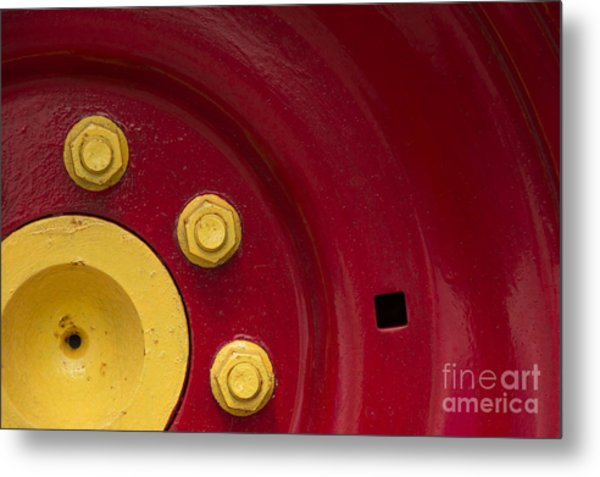 Three Yellow Nuts On A Red Wheel Metal Print
