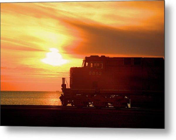 Train And Sunset Metal Print by Paul Kloschinsky