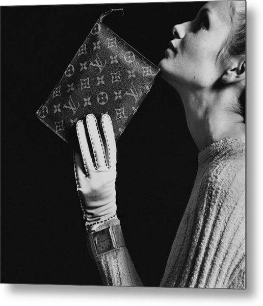 Twiggy Holding Louis Vuitton Envelope Bag Metal Print by Bert Stern
